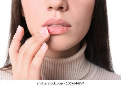 Young woman touching lips, closeup