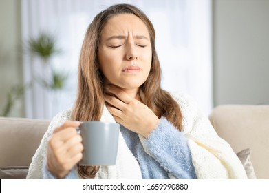 Young woman touching painful neck, sore throat for flu, cold and infection