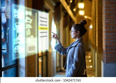 young woman touching screen choose icon on display sensitive panal is a modern future technology