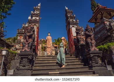 Young woman tourist in budhist temple Brahma Vihara Arama Banjar Bali, Indonesia