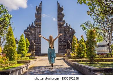 Young woman tourist in budhist temple Brahma Vihara Arama Banjar Bali, Indonesia