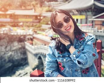 Young woman tourist in Haedong Yonggungsa Temple at Busan, South Korea.