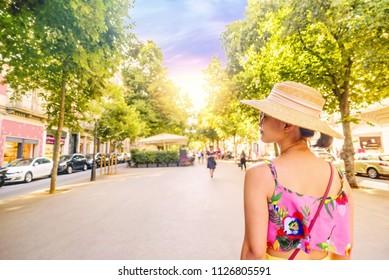 young woman tourist walking in barcelona rambla Catalunya rambla catalonia summer sunset sun sky