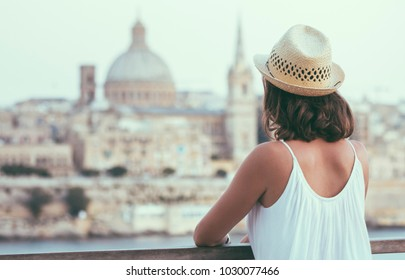 Young woman tourist watching Valletta - Malta  cityscape in summer