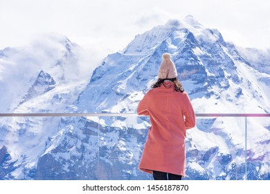 Young woman tourists enjoying on snow peak of Jungfraujoch, Switzerland.