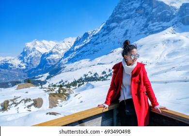 Young Woman Tourists see beautiful viewpoitn near Kleine Scheidegg station, along the railway from Interlaken to Jungfraujoch (3,466 m). In daylight atI Switzerland
