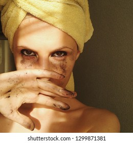 Young woman with towel on head looking in camera. Natural kajal powder for eyes