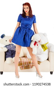 Young woman with toy bears at a sofa