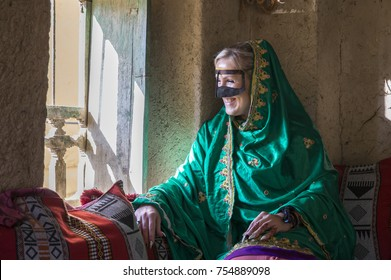 Young woman in traditional Omani dress in an old house