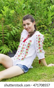 Young woman in traditional Romanian blouse outdoors