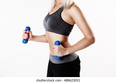 young woman to train with her dumbbell