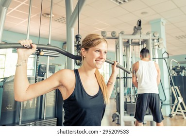 young woman training hard in the gym. concept about fitness, wellness and people