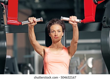 Young woman training in modern gym