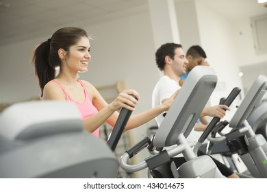 Young woman training on a cross trainer