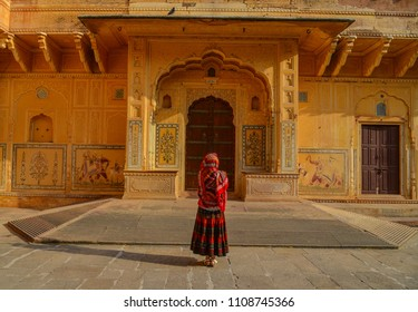 A young woman (travaler) standing at the ancient fort in Jaipur, India.