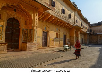 A young woman (travaler) walking at the ancient fort in Jaipur, India.