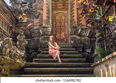 Young woman traveler in the background of Pura Taman Kemuda Saraswati Temple in Ubud, Bali island, Indonesia BANNER, long format