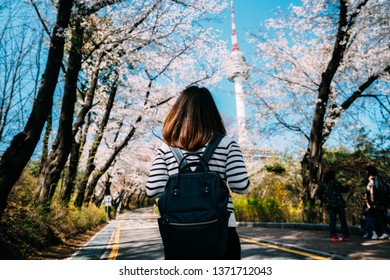 Young woman traveler backpacker traveling into N Seoul Tower at Namsan Mountain in Seoul City, South Korea