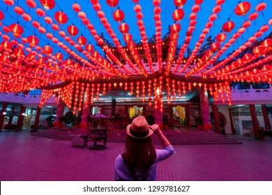 Young woman traveler traveling and looking red lanterns decorations in chinese temple name is Thean Hou Temple at Kuala Lumpur Malaysia. This place is famous during the celebration of Chinese New Year