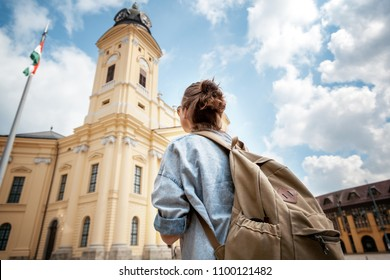 A young woman traveler visiting the sights in a summer trip across Europe, Hungary, Debrecen