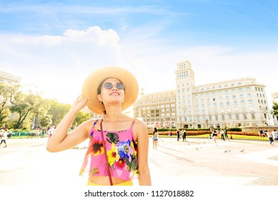 young woman traveling in Barcelona plaza catalunya summer sunny happy portrait travel touris