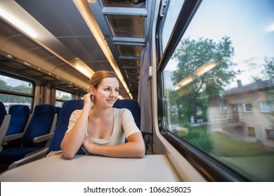Young woman traveling by train