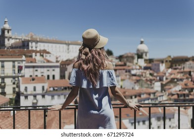 Young woman traveling on the street of Lisbon, Portugal