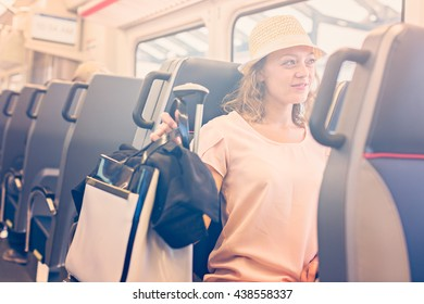 Young woman traveling from train station to International Airport.