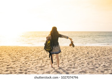Young woman traveller with backpack