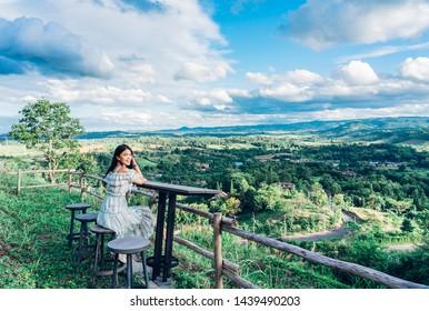Young woman traveller enjoying the mountain view of Phukaew Peak Khao kho at Phetchabun, Thailand.