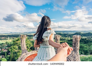 Young woman traveller leading boyfriend to the mountain view of Phukaew Peak Khao kho at Phetchabun, Thailand. Traveling together. Follow me