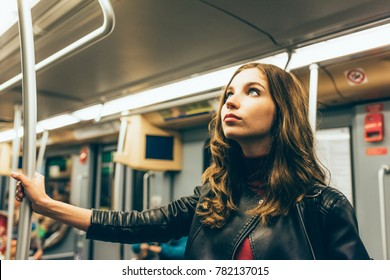 young woman travelling underground commuting - worker, transport, commuter concept