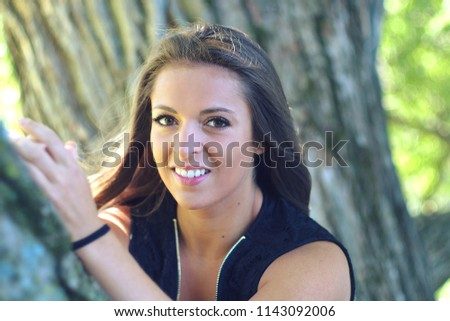 young woman in tree summer vacations portrait in nature