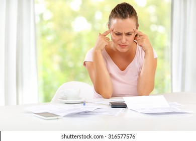 Young woman trying to figure out a way through a rough financial crisis