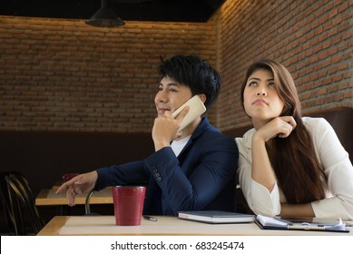 Young woman trying to listen gossip/Curious Girl Listening to Her Boyfriend Talking on The Phone - Girlfriend spying on her loved one eavesdropping private conversation