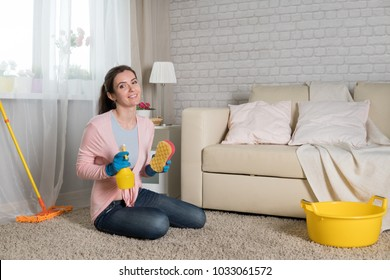 A young woman tucks into a house, a housewife does household chores
