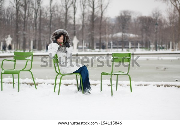 Young woman in the Tuileries garden on a winter day