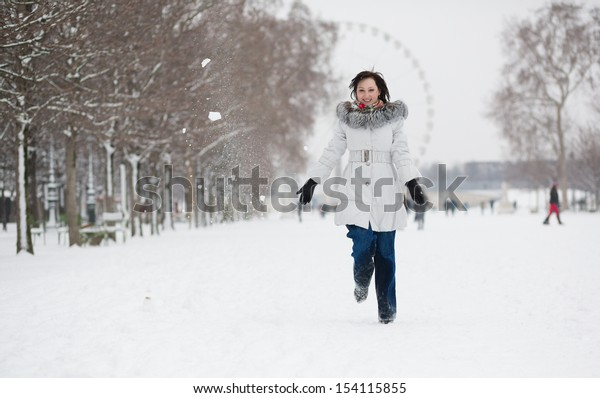 Young woman in Tuileries garden on a winter day