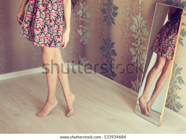 young woman turns the mirror
