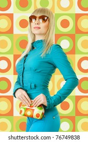 Young woman in turquoise dress posing against retro style background