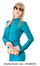 Young woman in turquoise dress posing over white background