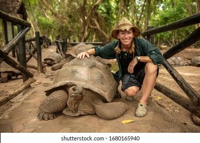 Young woman with a turtle, Zanzibar, Tanzania, Africa