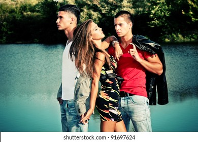 young woman with two young man, love triangle, outdoors shot