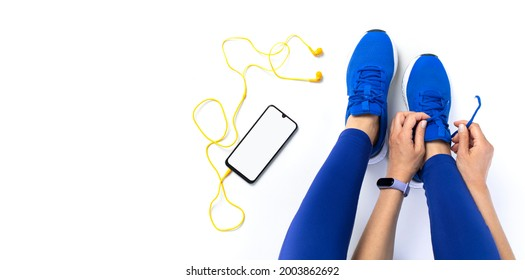 Young woman tying shoelace before workout, getting ready for jogging - Shutterstock ID 2003862692