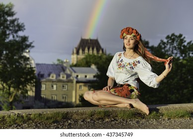 Young woman in Ukrainian costume at Quebec city, Canada with rainbow