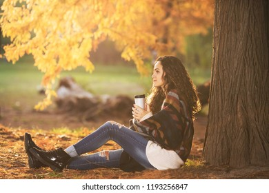 Young woman under the tree