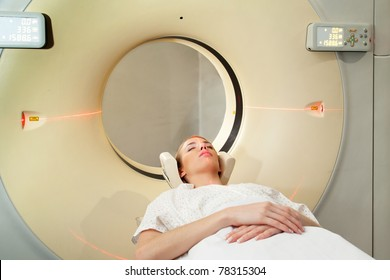 A young woman undergoing a CT scan in a hospital