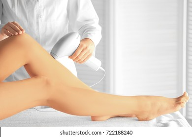 Young woman undergoing epilation procedure in beauty salon