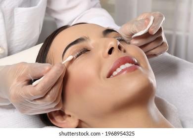 Young woman undergoing eyelash lamination in salon, closeup