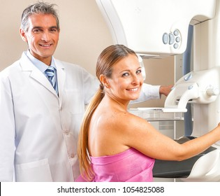 Young woman undergoing mammography with doctor supervision.